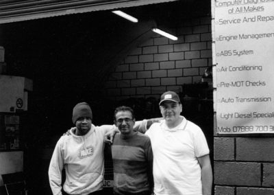 Three workmates, Mickey, Fayyaz and Mohammed at Umm-Al Qura Auto Care, Leabridge Road, Leytonstone E10